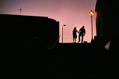 Solnedgångpar Fotografering för Bildbyråer