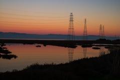 Solnedgångpyloner & berg Fotografering för Bildbyråer