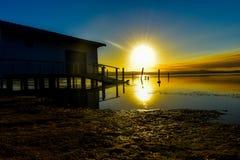 Solnedgångreflexion arkivfoto