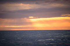 Solnedgångreflexion i havet Royaltyfria Bilder