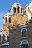 Solnedgångsikt av kyrkliga Sveti Sedmochislenitsi i stad av Sofia, Bulgarien Royaltyfri Bild
