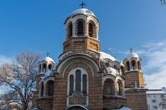 Solnedgångsikt av kyrkliga Sveti Sedmochislenitsi i stad av Sofia, Bulgarien Royaltyfri Fotografi