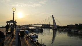 Solnedgångsikten av Tamsui fiskares hamnplats Det är en scenisk fläck på den västra spetsen av det Tamsui området, den Taipei sta royaltyfria foton