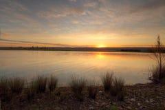 Solnedgångsikter över Duralia sjön Penrith Royaltyfri Foto