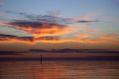 Solnedgångstolpe Arkivfoto
