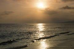 Solnedgångstrand, soluppgång Arkivfoto