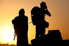 solnedgångturister Arkivfoto