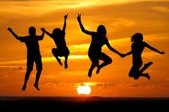 Solnedgångungar Fotografering för Bildbyråer