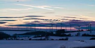 Solnedgångvindturbiner Fotografering för Bildbyråer