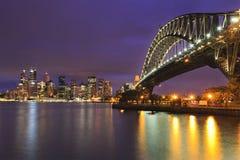 Solnedgång för mm för Sydney CBD bro 31 Royaltyfria Foton