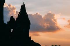 Solnedgång på den prambanan templet Arkivbilder