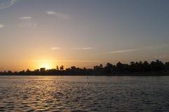 Solnedgång på Nile River Arkivbild