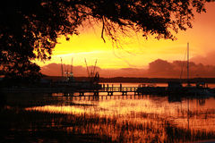 Solnedgång över skalleliten vik 1 Royaltyfri Bild