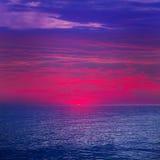 Solnedgångsoluppgång över medelhavet Arkivbild