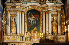 High altar in the Church of Saint Nicholas in Kali. The church of St. Nicholas in Kalisz was founded in 1253-1257. It was reubilt many times, with altar in the Royalty Free Stock Photo