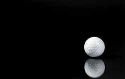 Solo. Image of one golf ball and reflection Stock Photo