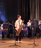 Solo bass saxophone. Folk Art Collective Big Band Veto - little band on the stage of the Kyiv Palace of children and youth. Jubilee kontsenrt jazz band Stock Photos