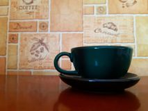 Solo blank ceramic mug on wooden table and modern  background. stock photo