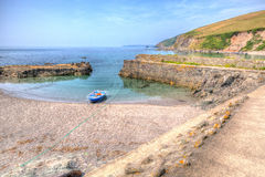 Solo boat in tiny harbour at Portwrinkle Stock Photos