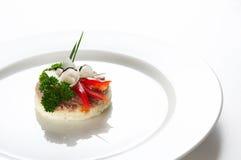 Solo bocado en el plato blanco Foto de archivo libre de regalías