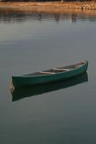 Solo Canoe Moored in the Water stock photo