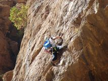 Solo climber in Todra Gorges in Morocco stock photos