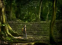 Solo Female Traveler In Forest. Solo female traveler in ancient forest ruins stock photography