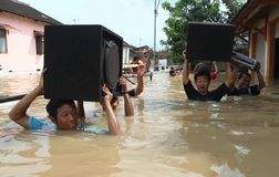 Solo flood. People trying to Save their goods when flood came in Solo, central java, indonesia royalty free stock image