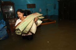 Solo flood. People trying to Save their goods when flood came in Solo, central java, indonesia stock images