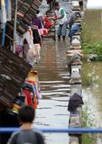 Solo flood. People trying to Save their goods when flood came in Solo, central java, indonesia Stock Photo