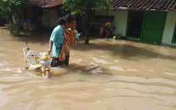 Solo flood. Women Save the goods belong to her whose house flooded in Solo, central java, indonesia Stock Photos