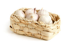 Solo garlic in braided basket Stock Photo