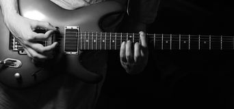 Solo guitarist. Play on guitar BW stock photography