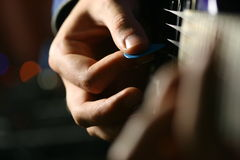 Solo guitarist. Play on six strings stock images