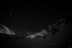 Solo light. Mountains, stars and moonlight, all together in a black and white night photography Stock Photo