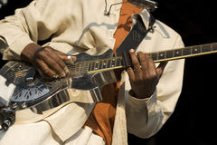 Solo Performance. Black hands playing a steel guitar Royalty Free Stock Photos