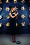 Solo performance of female singer in front of the silver vintage Stock Images