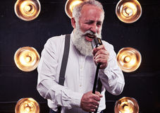 Solo performance of male singer in front of the silver vintage m Stock Images