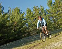 Solo Riding. Woman out for a bike ride on a suny afternoon in Wasaga Beach Provincial Park Royalty Free Stock Photography