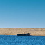 Solo Rowboat Moored on Sandy Beach Royalty Free Stock Photo