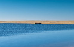 Solo Rowboat Moored on Sandy Beach Stock Photo