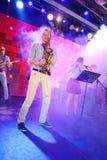 Solo saksofon Młodzi geniuszi jazz przy świetlicowy olimpia Obrazy Royalty Free