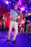 Solo saxophone. Young geniuses of jazz at the club Olympia. Royalty Free Stock Images