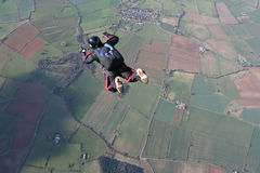 Solo skydiver in freefall. On a sunny day Stock Photos