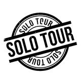 Solo Tour rubber stamp. Grunge design with dust scratches. Effects can be easily removed for a clean, crisp look. Color is easily changed Stock Photos