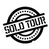Solo Tour rubber stamp. Grunge design with dust scratches. Effects can be easily removed for a clean, crisp look. Color is easily changed Royalty Free Stock Images