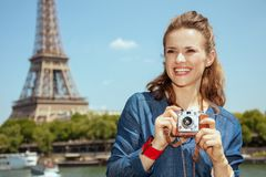 Solo tourist woman with retro photo camera stock image