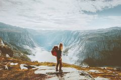 Solo traveling girl hiking with backpack in mountains. Adventure journey lifestyle vacations weekend getaway in Norway royalty free stock image