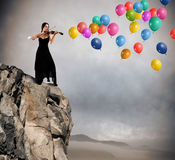 Solo violinist with balloon Royalty Free Stock Photos