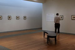 Solo visitor walking through room admiring beautiful artwork, Portland Art Museum,Maine,2016 Stock Photos